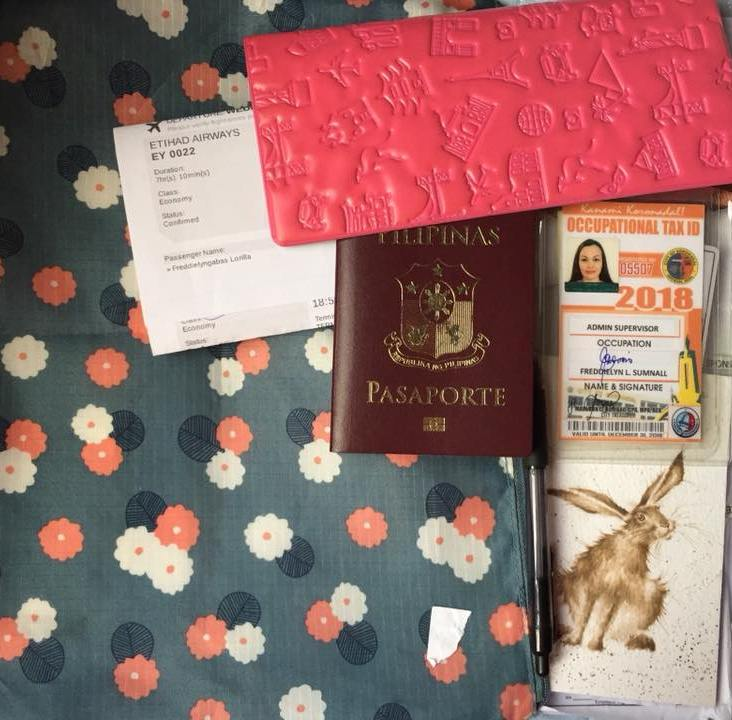 Document pouch: passport with passport holder, flight itineraries, supporting documents in case the IO asks for them, pen, company ID, and small notepad