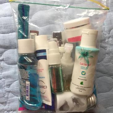 All liquid, gel, and cream based toiletries all in 100ml or less canisters/tubes for easy airport security check-in